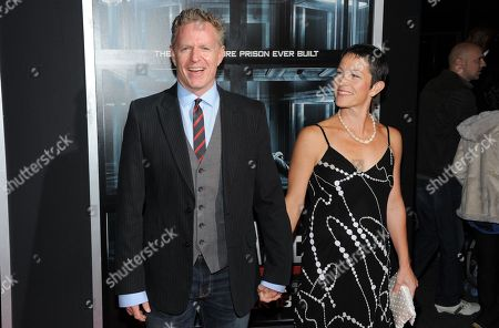 """Stock Image of Screenwriter Miles Chapman and wife Erica attend the premiere of """"Escape Plan"""" at the Regal E-Walk on in New York"""