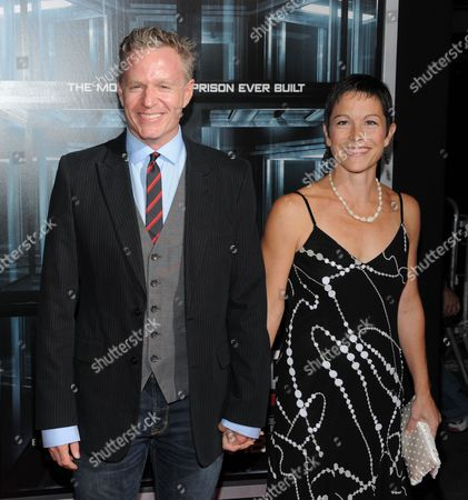 """Screenwriter Miles Chapman and wife Erica attend the premiere of """"Escape Plan"""" at the Regal E-Walk on in New York"""