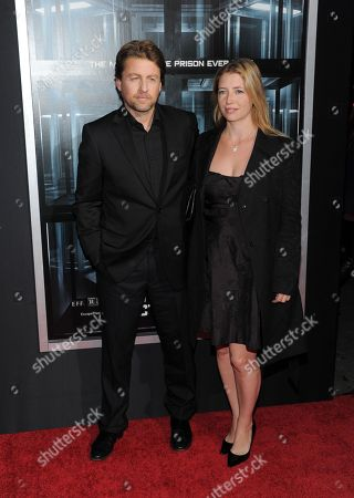 """Director Mikael Hafstrom and wife Kelly attend the premiere of """"Escape Plan"""" at the Regal E-Walk on in New York"""