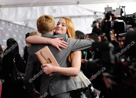 """Actors Jack Gleeson and Sophie Turner attend HBO's """"Game of Thrones"""" fourth season premiere at Avery Fisher Hall on in New York"""