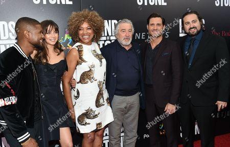 "Actor Usher Raymond, left, actor Ana De Armas, Grace Hightower, actor Robert De Niro, actor Edgar Ramirez and director Jonathan Jakubowicz pose together at the U.S. premiere of ""Hands of Stone"" at the SVA Theatre, in New York"