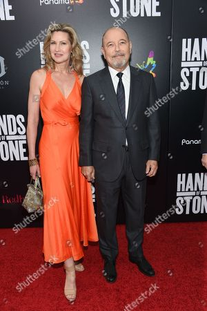 "Stock Image of Actor Rubén Blades and wife Luba Mason attend the U.S. premiere of ""Hands of Stone"" at the SVA Theatre, in New York"