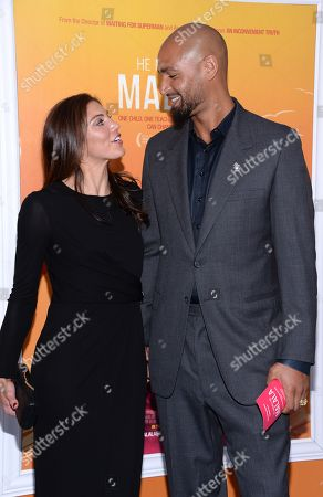"""Hope Solo, left, and Jerramy Stevens attend the premiere of """"He Named Me Malala"""" at The Ziegfeld Theatre, in New York"""