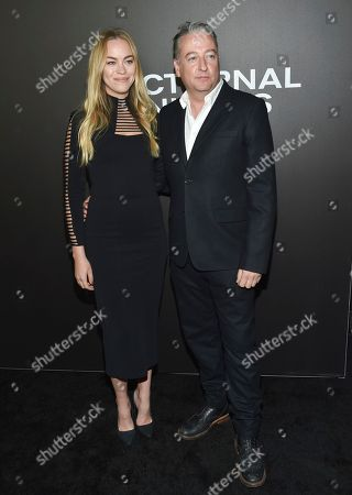 "Composer Seamus McGarvey and guest attend the premiere of ""Nocturnal Animals"" at the Paris Theatre, in New York"