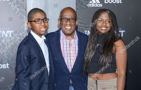 """Al Roker, center, and his children Nicholas Roker and Leila Roker attend the premiere of """"The Divergent Series: Insurgent"""" at the Ziegfeld Theatre, in New York"""