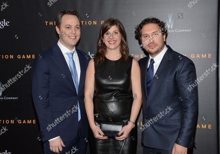 """Producers Ido Ostrowsky, left, Nora Grossman and Teddy Schwarzman attend the premiere of """"The Imitation Game"""" at Ziegfeld Theatre, in New York"""