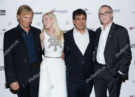 """Actors Viggo Mortensen, left, and Kirsten Dunst pose with director Hossein Amini and Magnolia president Eamonn Bowles at the premiere of """"The Two Faces of January"""" at the Landmark Sunshine Theater, in New York"""