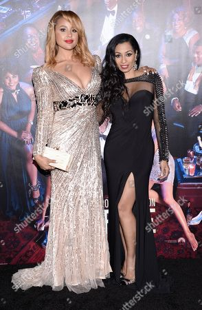 "Actresses Hayley Marie Norman, left, and Karlie Redd attend the premiere of ""Top Five"" at the Ziegfeld Theatre, in New York"