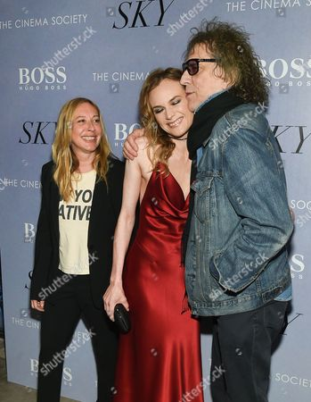 """French director Fabienne Berthaud, left, actress Diane Kruger and photographer Mick Rock attend a special screening of """"Sky"""", hosted by The Cinema Society and Hugo Boss, at Metrograph, in New York"""