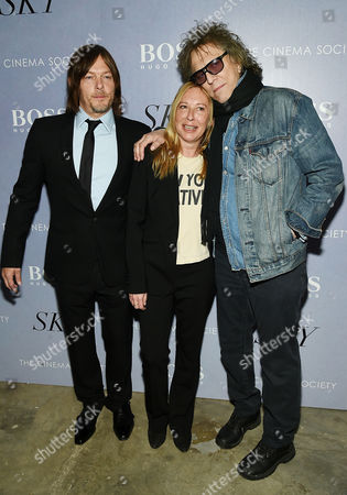 """Actor Norman Reedus, left, director Fabienne Berthaud and British photographer Mick Rock attend a special screening of """"Sky"""", hosted by The Cinema Society and Hugo Boss, at Metrograph, in New York"""