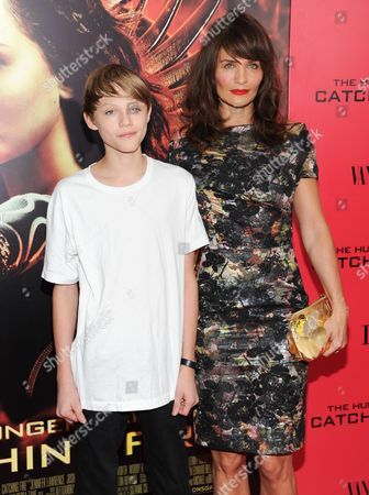 """Helena Christensen and son Mingus Reedus attend a special screening of """"The Hunger Games: Catching Fire"""" at AMC Lincoln Square on in New York"""