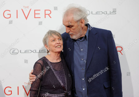 "Stock Image of Author Lois Lowry and director Phillip Noyce attend the world premiere of ""The Giver"" at the Ziegfeld Theatre, in New York"