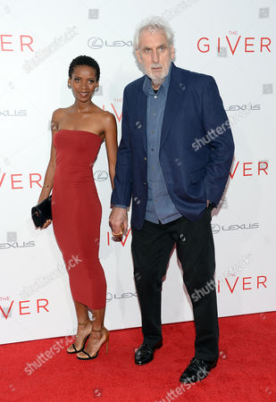 "Stock Picture of Director Phillip Noyce and wife Vuyo Dyasi attend the world premiere of ""The Giver"" at the Ziegfeld Theatre, in New York"