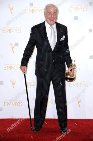 "Producer Jerry Weintraub poses in the press room with the award for outstanding documentary or nonfiction series for Years of Living Dangerously at the 2014 Creative Arts Emmys in Los Angeles. Weintraub, the dynamic producer and manager who pushed the career of John Denver and produced such hit movies as ""Nashville"" and ""Ocean's Eleven,"" died, of cardiac arrest in Santa Barbara, Calif. He was 77"