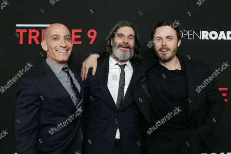 Producer Marc Butan, Producer Anthony Katagas and Casey Affleck seen at Open Road's 'Triple 9' Los Angeles Premiere at Regal L.A. Live, in Los Angeles, CA