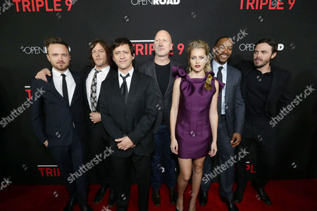 Aaron Paul, Norman Reedus, Clifton Collins Jr., Director John Hillcoat, Teresa Palmer, Anthony Mackie and Casey Affleck seen at Open Road's 'Triple 9' Los Angeles Premiere at Regal L.A. Live, in Los Angeles, CA