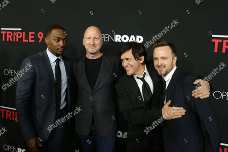 Anthony Mackie, Director John Hillcoat, Clifton Collins Jr. and Aaron Paul seen at Open Road's 'Triple 9' Los Angeles Premiere at Regal L.A. Live, in Los Angeles, CA