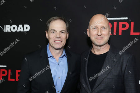 Tom Ortenberg, Chief Executive Officer of Open Road Films, and Director John Hillcoat seen at Open Road's 'Triple 9' Los Angeles Premiere at Regal L.A. Live, in Los Angeles, CA