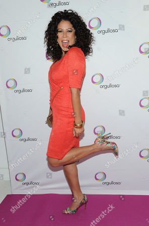 """Evette Rios, of ABC's """"The Chew,"""" helps Procter & Gamble's Orgullosa community unveil its """"Skirts Only"""" fashion show, in New York, featuring exclusive designs from CENIA. Orgullosa was created to celebrate, empower and fuel Latinas' accomplishments. Visit Facebook.com/Orgullosa for more information"""
