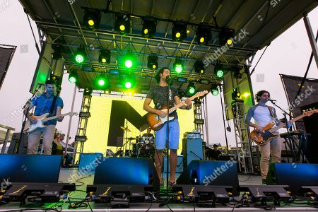 From left, guitarist Mark Pellizzer, vocalist Nasri Atweh, drummer Alex Tanas, and bassist Ben Spivak of the band Magic! perform on stage during the Pandora Presents The 2014 Summer Party at The Santa Monica Pier, in Santa Monica, Calif