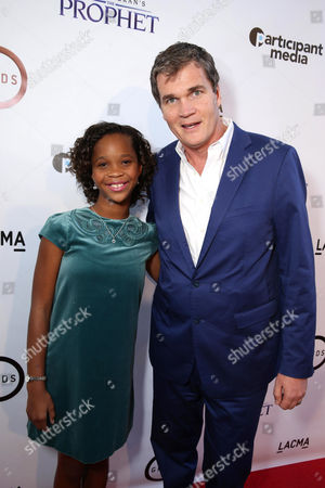 "Stock Photo of Quvenzhane Wallis and producer Clark Peterson seen at Participant Media Special Los Angeles Screening of ""Kahlil Gibran's The Prophet"" held at LACMA's Bing Theater, in Los Angeles"