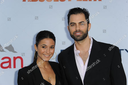 Emmanuelle Chriqui, at left, and Adrian Bellani arrives at Pathway to the Cure Benefit at Santa Monica Airport, in Santa Monica, CA