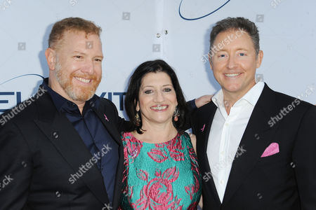 Stock Picture of Dr. Judith Salerno, from left, Ryan Cavanaugh, and Jim Plante arrives at Pathway to the Cure Benefit at Santa Monica Airport, in Santa Monica, CA