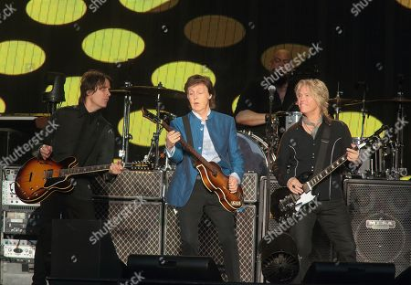 Rusty Anderson, from left, Paul McCartney and Brian Ray perform in concert at Hersheypark Stadium, in Hershey, Pa