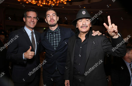 Mayor of Los Angeles Eric Garcetti, Honoree Salvador Santana and Honoree Carlos Santana seen at Peace Over Violence 42nd Annual Humanitarian Awards, on Friday, Oct., 25, 2013 in Beverly Hills, Calif