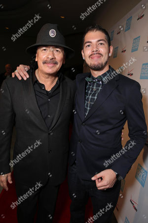 Honorees Carlos Santana and Salvador Santana seen at Peace Over Violence 42nd Annual Humanitarian Awards, on Friday, Oct., 25, 2013 in Beverly Hills, Calif