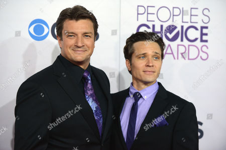 Nathan Fillion, left, and Seamus Dever arrive at the People's Choice Awards at the Nokia Theatre, in Los Angeles
