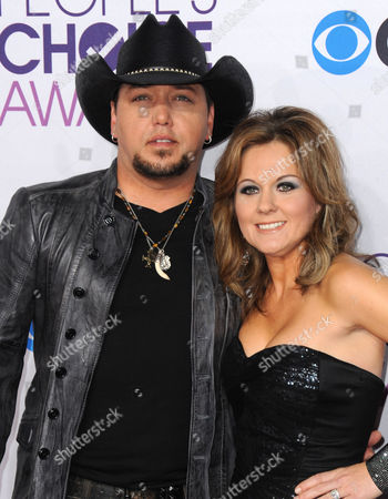 Stock Photo of Jason Aldean and Jessica Aldean arrive at the People's Choice Awards at the Nokia Theatre, in Los Angeles
