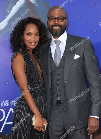 """Mara Brock Akil and Salim Akil attend the Los Angeles premiere of """"Sparkle"""" at Grauman's Chinese Theatre, in Los Angeles"""