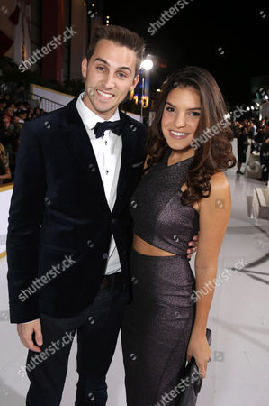 "Cody Johns and Alexys Gabrielle seen at the Los Angeles Premiere of Lionsgate's ""The Hunger Games: Mockingjay - Part 1"" held at Nokia Theater L.A. Live, in Los Angeles"