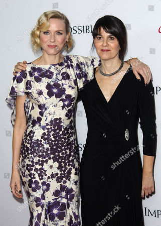"""Actress Naomi Watts, left, and producer Maria Belon pose together at the premiere of """"The Impossible"""" at the Arclight Cinerama Dome, in Los Angeles. Belon survived the 2004 Indian Ocean tsunami and her story is the subject of the film"""