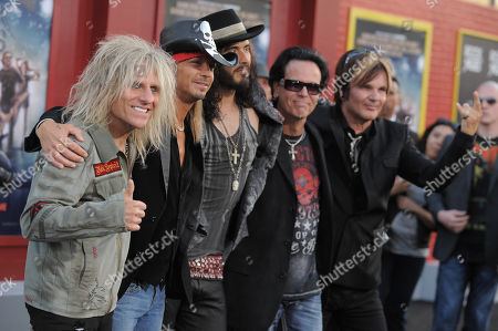 "Russell Brand, center, and from left, C.C. DeVille, Bret Michaels, Bobby Dall and Rikki Rockett, of musical group Poison, arrive at the ""Rock of Ages"" premiere at Grauman's Chinese Theatre on in Los Angeles"
