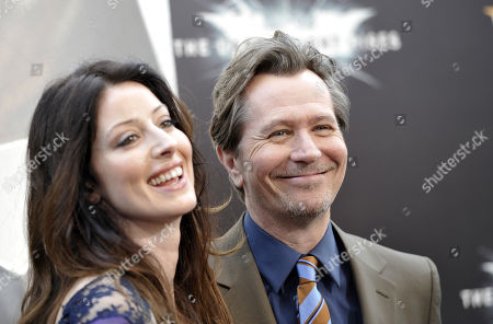 """Actor Gary Oldman and wife Alexandra Edenborough attend the world premiere of """"The Dark Knight Rises"""" at the AMC Lincoln Square Theater on in New York"""