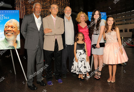 """Rob Reiner, third from left, director of """"The Magic of Belle Isle,"""" poses with cast members, from left, Morgan Freeman, Fred Willard, Nicolette Pierini, Virginia Madsen, Madeline Carroll and Emma Fuhrmann at the premiere for the film at the Director's Guild of America on in Los Angeles"""