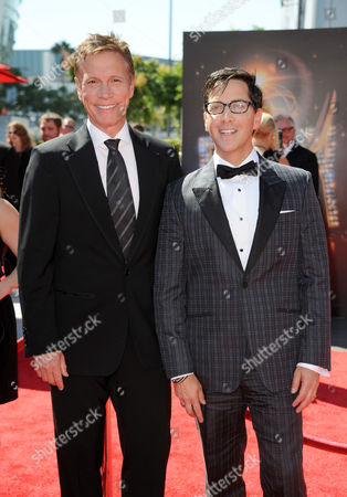 Don Roos, left, and Dan Bucatinsky arrive at the Primetime Creative Arts Emmy Awards at the Nokia Theatre L.A. Live, in Los Angeles