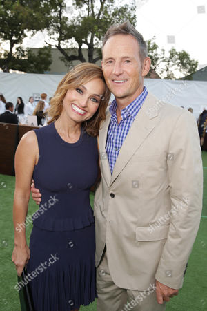 Stock Image of Honoree Giada De Laurentiis and Todd Thompson seen at Project Angel Food's Annual Angel Awards Celebration, on Saturday, August, 10, 2013 in Los Angeles