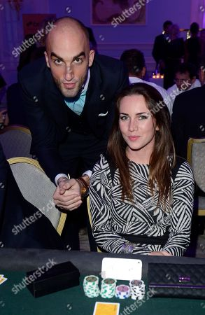 Drummond Money-Coutts, left, and Liv Boeree are seen at the Quintessentially Foundation's annual poker evening in association with Betfair at the Savoy Hotel on in London. The Quintessentially Foundation is the charitable arm of Quintessentially Lifestyle