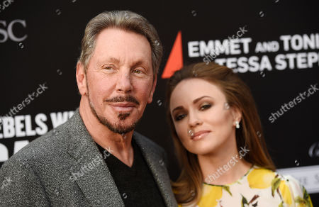 Oracle founder Larry Ellison, left, poses with girlfriend Nikita Kahn at the Rebels With A Cause Gala at The Barker Hangar, in Santa Monica, Calif
