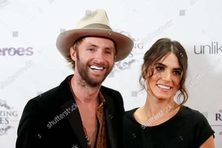 Actress Nikki Reed, right, and husband musician Paul McDonald, left, arrive at the Recognizing Heroes Awards Dinner and Gala at the W Hotel Hollywood on in Los Angeles