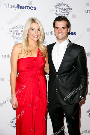 Founder of Unlikely Heroes Erica Greve, left, and Director of Outreach for Unlikely Heroes Ben Decker, right, arrive at the Recognizing Heroes Awards Dinner and Gala at the W Hotel Hollywood on in Los Angeles