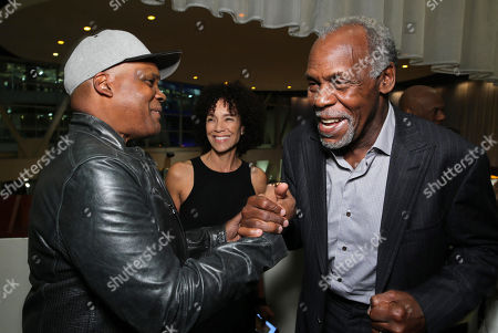 """Producer Reggie Rock Bythewood and Danny Glover attend the premiere for Relativity Studios' and BET Studios' """"Beyond the Lights"""" held at the Arclight Hollywood theater, in Los Angeles"""