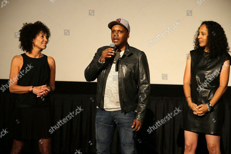 """Producer Stephanie Allain, Producer Reggie Rock Bythewood and Director/Writer Gina Prince-Bythewood attend the premiere for Relativity Studios' and BET Studios' """"Beyond the Lights"""" held at the Arclight Hollywood theater, in Los Angeles"""