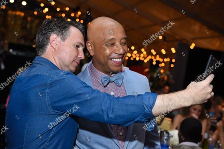 Jason Binn and Russell Simmons take a selfie at the RUSH Philanthropic Arts Foundation's Art for Life Benefit at Fairview Farms in Water Mill, in New York