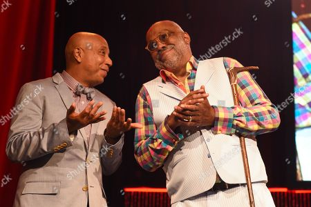 Russell Simmons and Danny Simmons Jr. appear on stage RUSH Philanthropic Arts Foundation's Art for Life Benefit at Fairview Farms in Water Mill, in New York