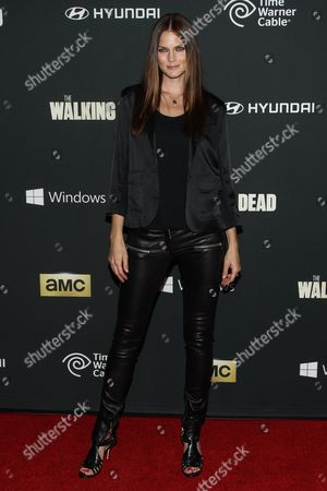 """Stock Picture of Model Mini Anden arrives at the season 4 premiere of """"The Walking Dead"""" at the AMC Universal Citywalk Stadium 19/IMAX on in Universal City, Calif"""