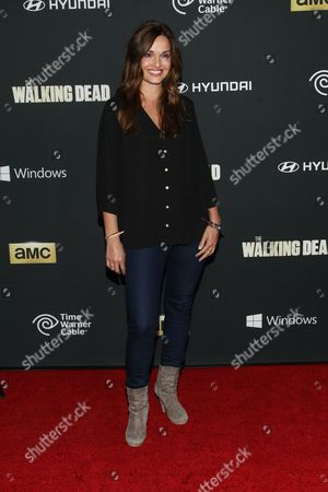 """Stock Picture of Actress Gloria Votsis arrives at the season 4 premiere of """"The Walking Dead"""" at the AMC Universal Citywalk Stadium 19/IMAX on in Universal City, Calif"""